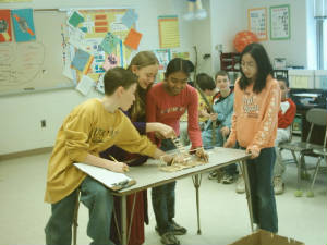 Sixth Graders testing their catapults.