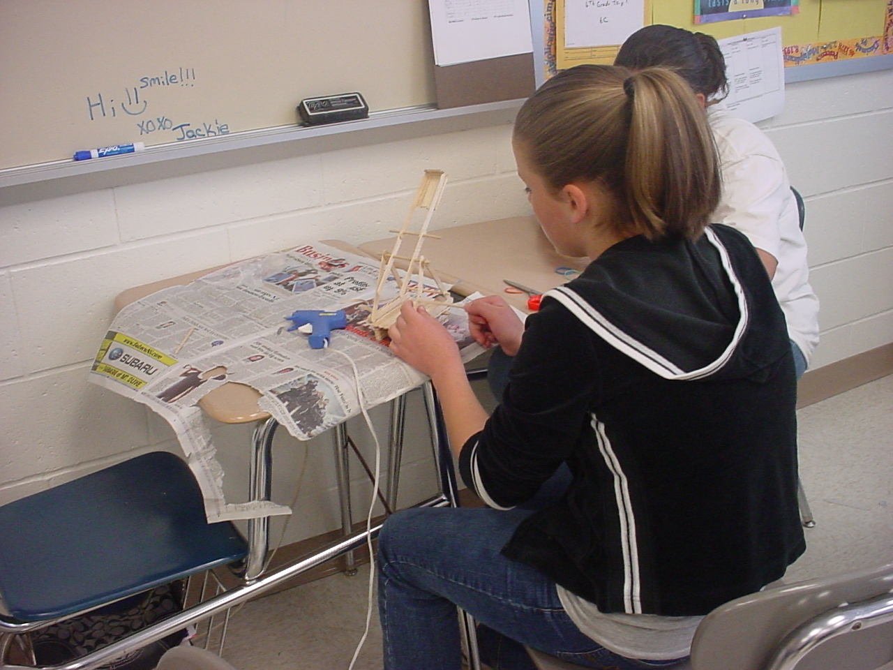 6th grade girl building catapult