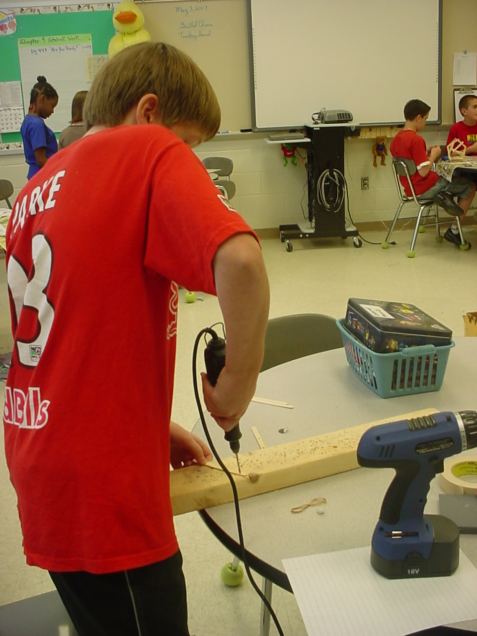 6th grade boy using power tools
